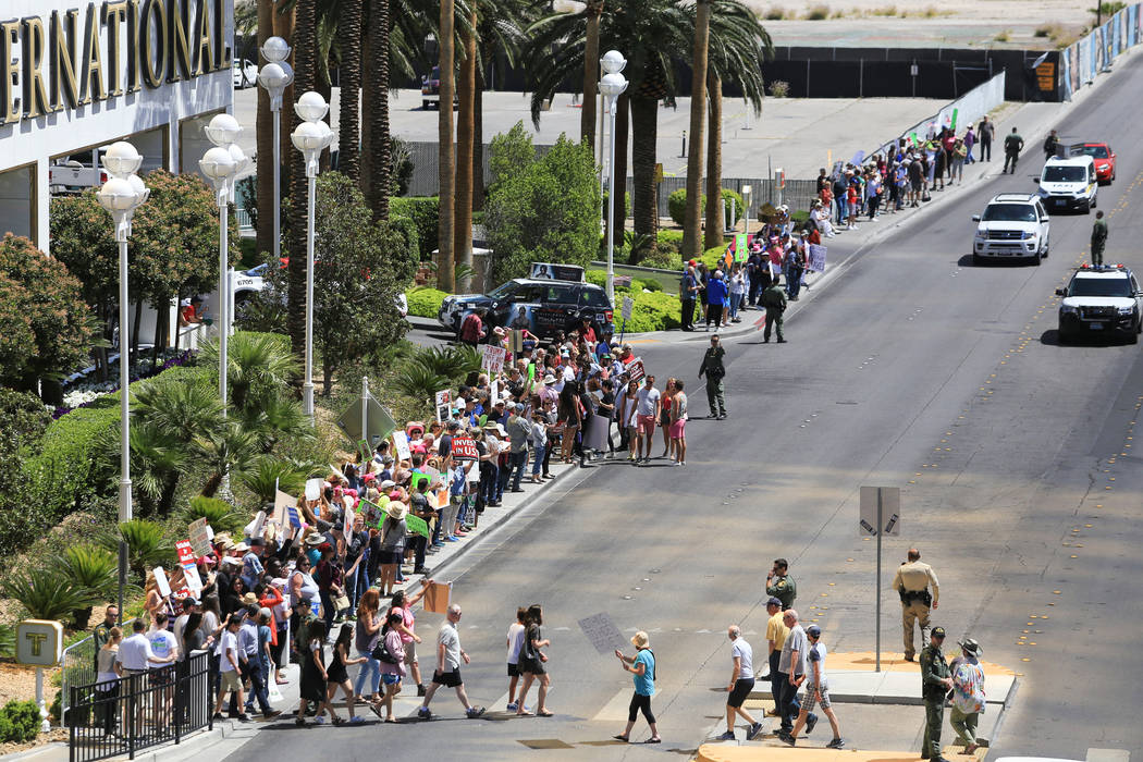 Demonstrators line Fashion Show Drive during a tax day protest at Trump International Hotel on Saturday, April 15, 2017. Brett Le Blanc Las Vegas Review-Journal @bleblancphoto