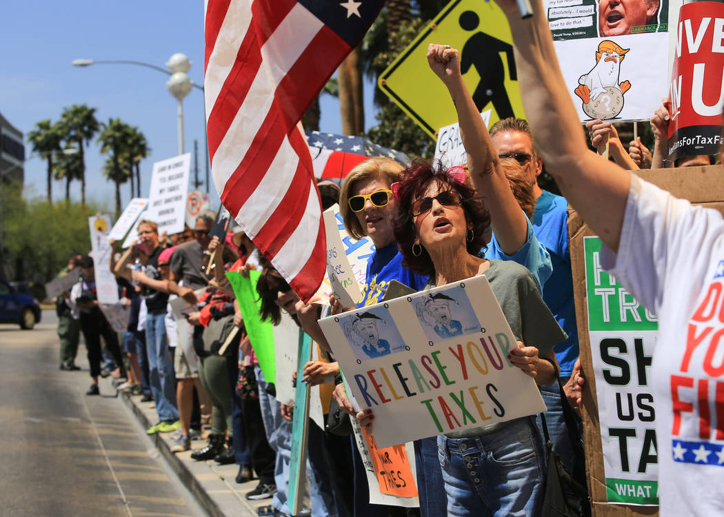 Demonstrators chant for President Donald Trump to release his tax returns during a tax day protest at Trump International Hotel on Saturday, April 15, 2017. Brett Le Blanc Las Vegas Review-Journal ...