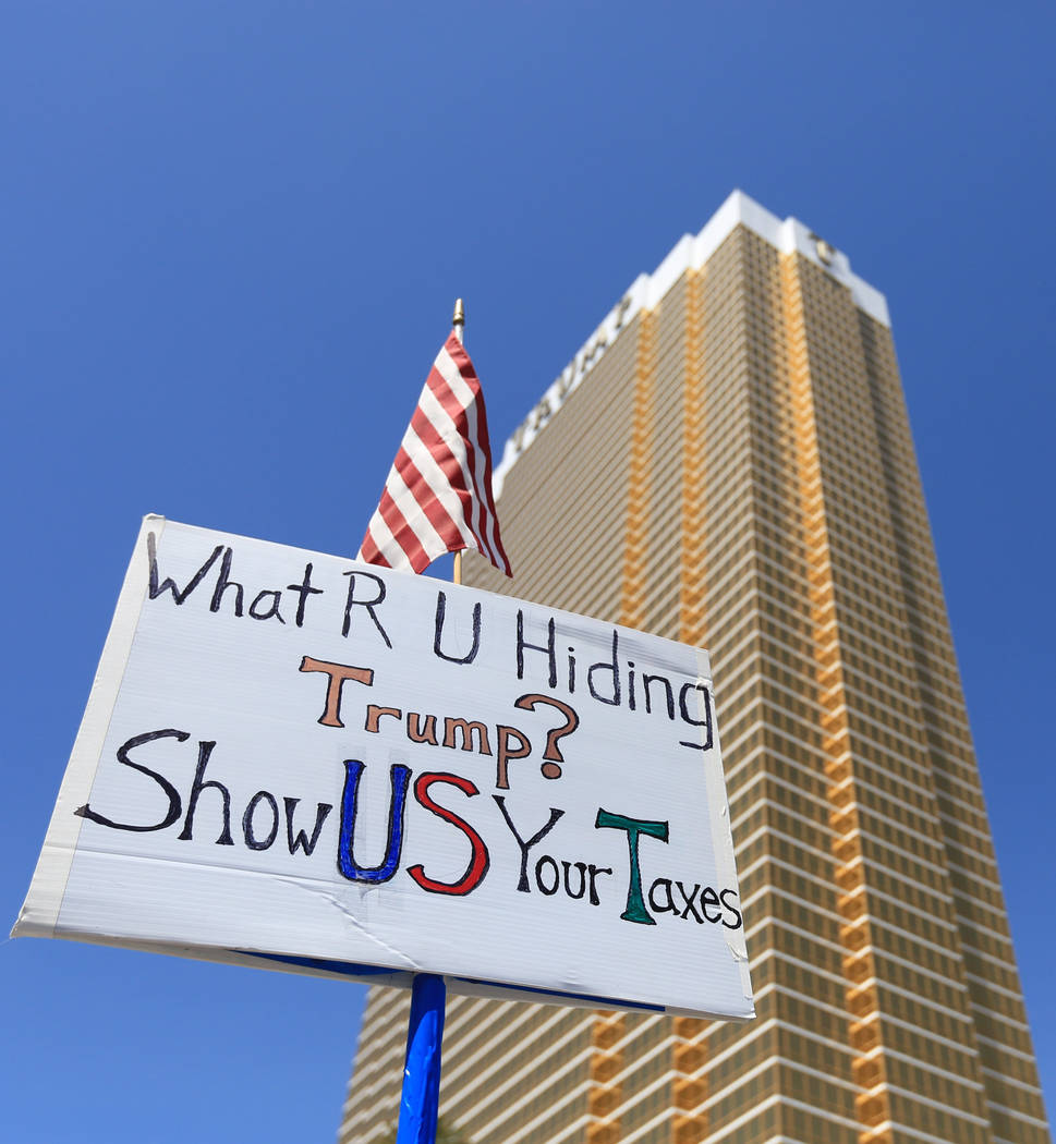 A demonstrator hold a sign asking President Donald Trump to release his tax returns during a tax day protest at Trump International Hotel on Saturday, April 15, 2017. Brett Le Blanc Las Vegas Revi ...