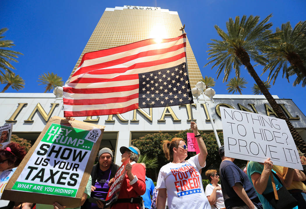 Colleen Brola, center right, holds an upside down American flag during a tax day protest at Trump International Hotel on Saturday, April 15, 2017. Brett Le Blanc Las Vegas Review-Journal @bleblanc ...