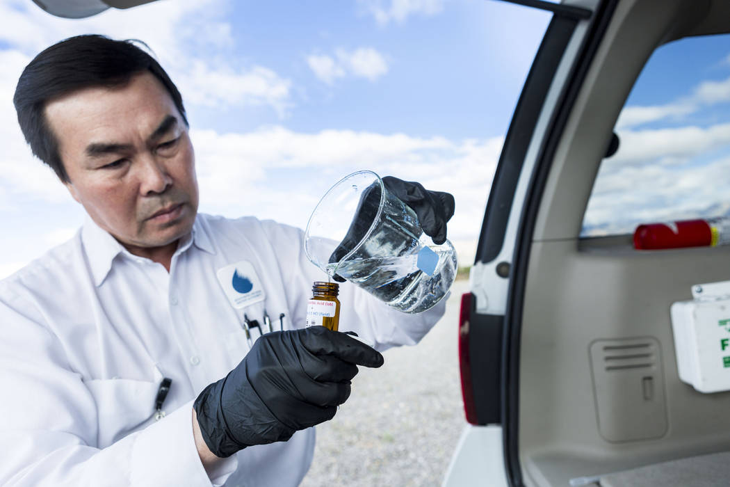 Water Quality Monitoring Field Specialist Daniel Luong tests water samples from the the Montessori reservoir that holds 20 million gallons of water located at Montessori Street and Warm Springs Ro ...