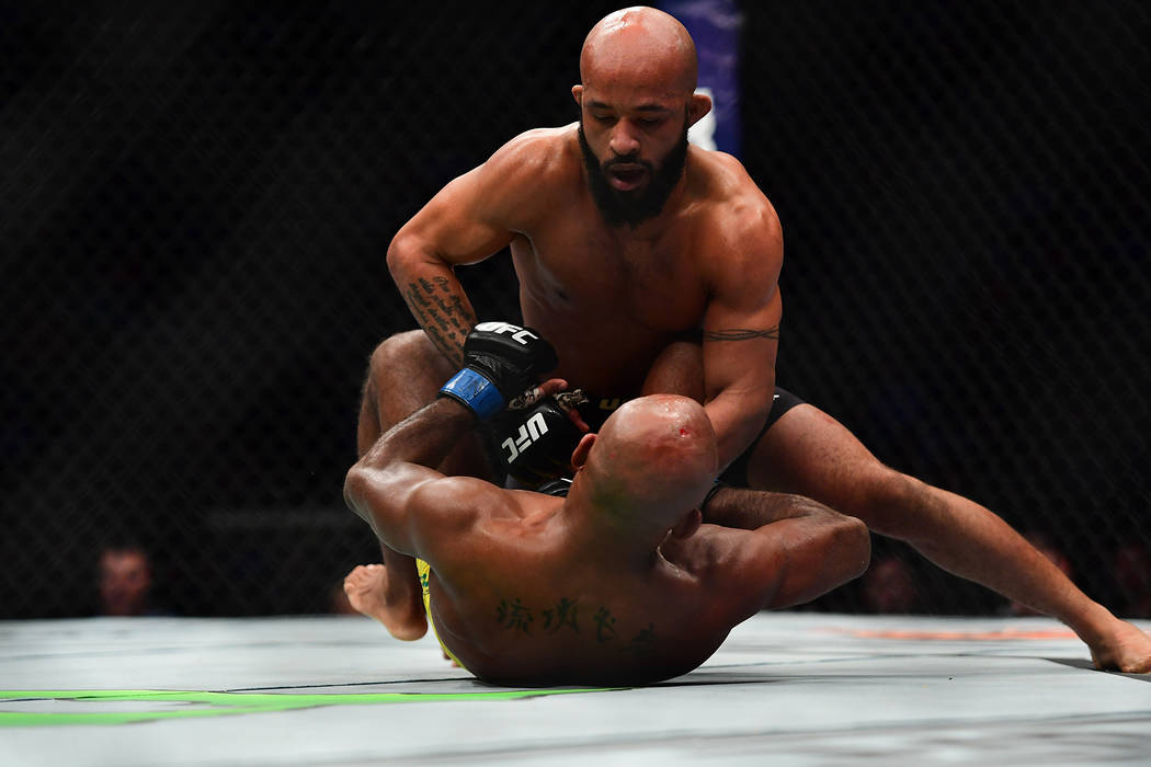 UFC's Demetrious Johnson ties record with 10th straight ...