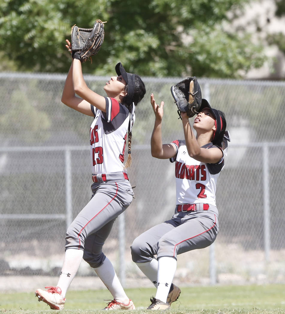 Las Vegas High's Sabrina Saldate, left, and Angelina Visitacion prepare to catch the ball during their game against Liberty High on Saturday, April 22, 2017, in Henderson. Bizuayehu Tesfaye Las Ve ...