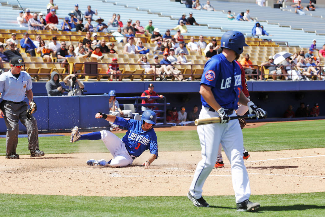 Las Vegas 51s T.J. Rivera steals home against the Sacramento River Cats at Cashman Field in Las Vegas on Sunday, April 16, 2017. Rachel Aston Las Vegas Review-Journal @rookie__rae