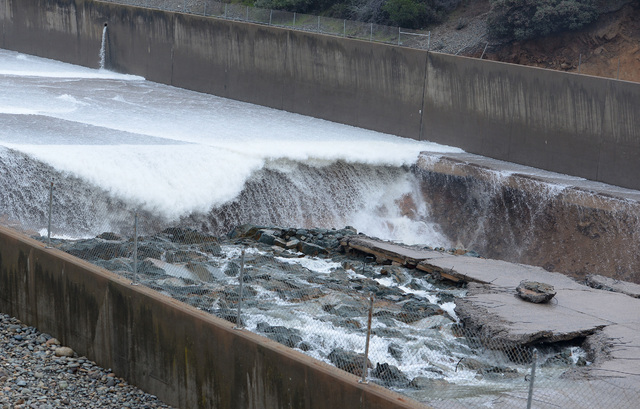 Some concrete of the Lake Oroville Dam's spillway is seen damaged in Oroville, Calif., Tuesday Feb. 7, 2017. Managers of Lake Oroville, one of the state's largest reservoirs, stopped sending water ...