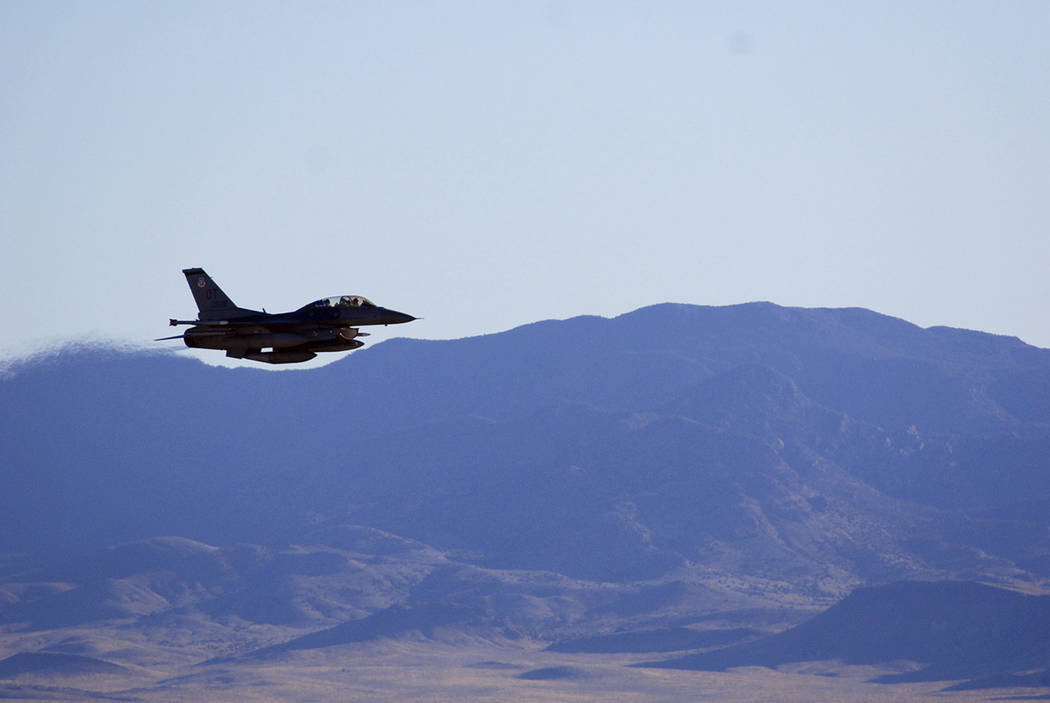An F-16C makes a pass over Nevada's Tonopah Test Range after a March test of a mock nuclear weapon as part of a life extension program for the B61-12, near Tonopah in March. (John Salois/Sandia Na ...