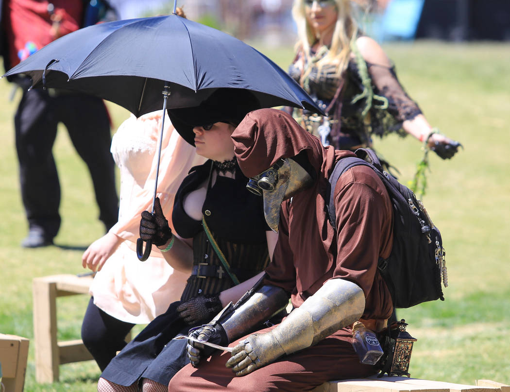 Amber Grothem, left, dressed in steampunk style and Chandler Williams, right, dressed as a plague doctor, watch the opening ceremony during Pirate Fest 2017 at Craig Ranch Regional Park on Friday, ...