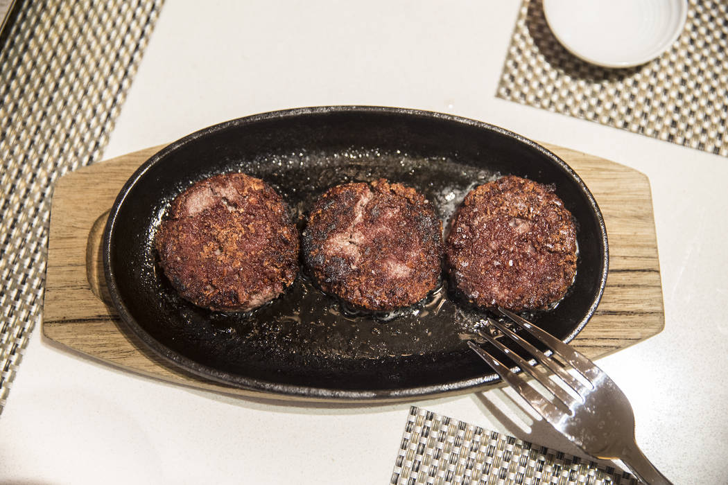 Impossible burgers sizzle on a hot griddle before being served at Andrea's at Encore at the Wynn Las Vegas hotel-casino, on Friday, April 14, 2017, in Las Vegas. The meatless burgers are made with ...