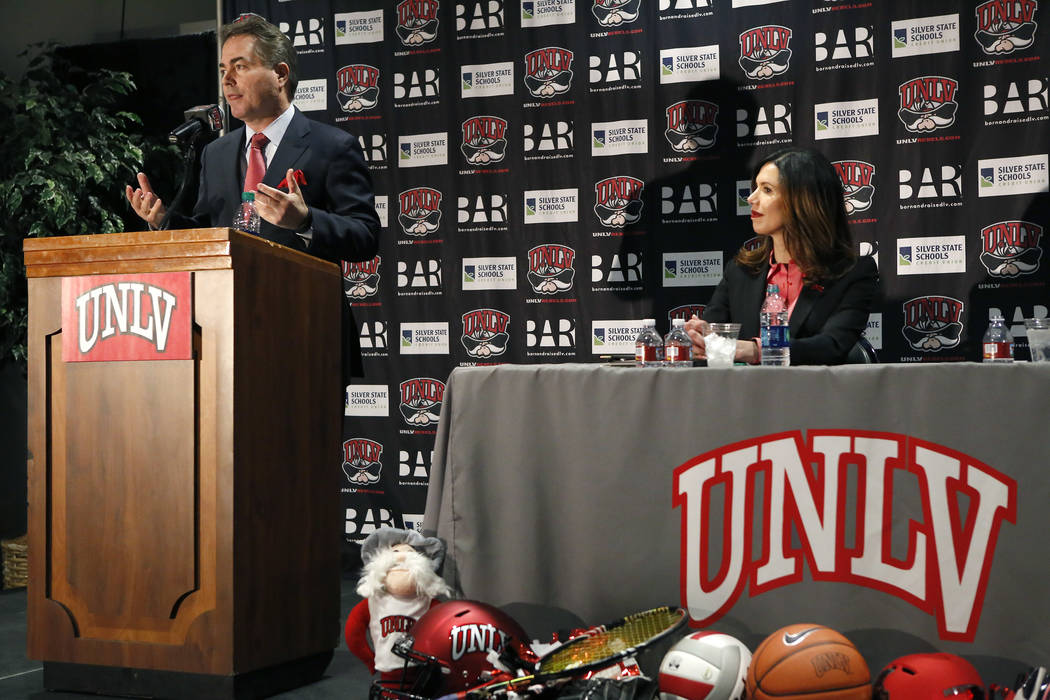 UNLV's President Len Jessup, from left, and Desiree Reed-Francois at the Thomas & Mack Center during a press conference where Reed-Francois was announced as the university's new athletic direc ...