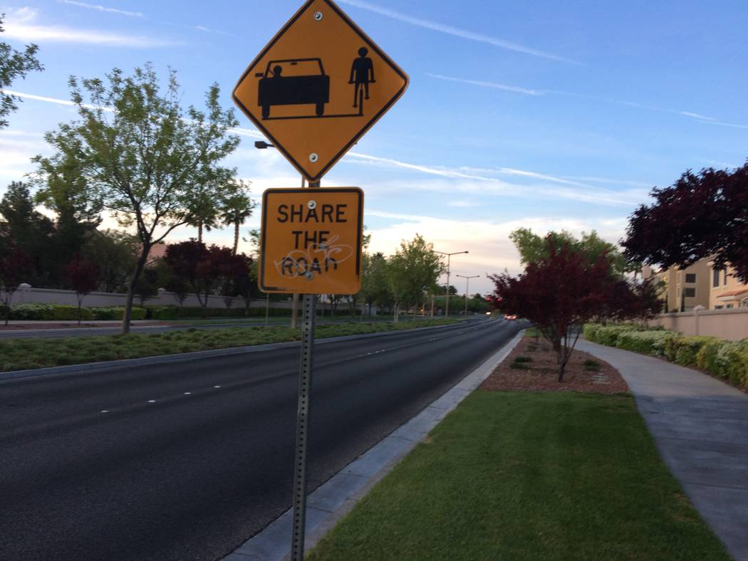 A sign warning drivers of the presence of pedestrians is seen April 11, 2017 on Hillpointe Drive. Residents are complaining that motorists drive too fast in the area. (Jan Hogan/View)