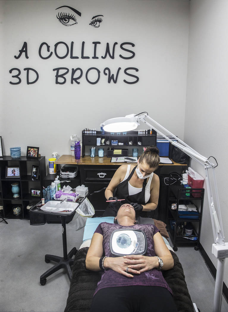Audrey Collins, back, microblades Angie Lapp's eyebrows at The Body Spa Salon on Tuesday, April 18, 2017, in Henderson. Benjamin Hager Las Vegas Review-Journal @benjaminhphoto