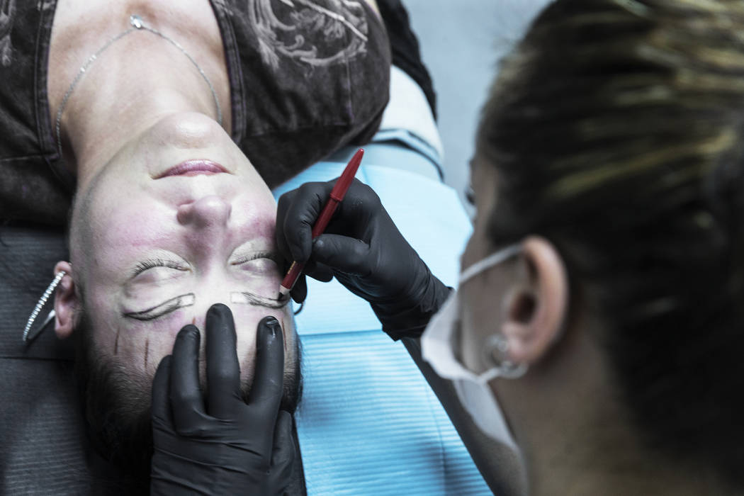 Angie Lapp, left, gets her eyebrows microbladed by Audrey Collins at The Body Spa Salon on Tuesday, April 18, 2017, in Henderson.  Benjamin Hager Las Vegas Review-Journal @benjaminhphoto