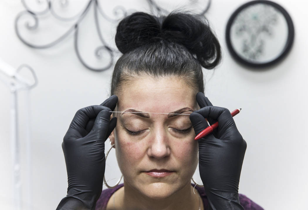 Angie Lapp gets her eyebrows microbladed by Audrey Collins at The Body Spa Salon on Tuesday, April 18, 2017, in Henderson. Benjamin Hager Las Vegas Review-Journal @benjaminhphoto