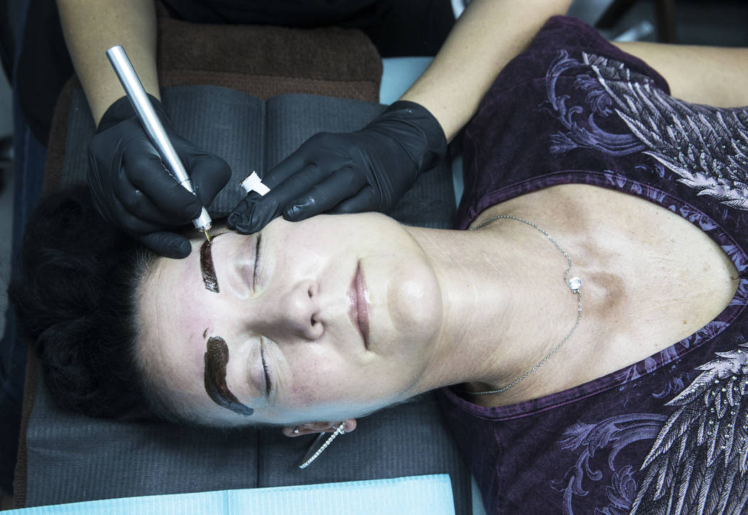 Angie Lapp gets her eyebrows microbladed at The Body Spa Salon on Tuesday, April 18, 2017, in Henderson. Benjamin Hager Las Vegas Review-Journal @benjaminhphoto