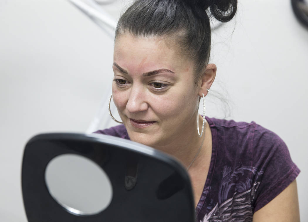 Angie Lapp looks in the mirror during her eyebrow microblade session at The Body Spa Salon on Tuesday, April 18, 2017, in Henderson.  Benjamin Hager Las Vegas Review-Journal @benjaminhphoto