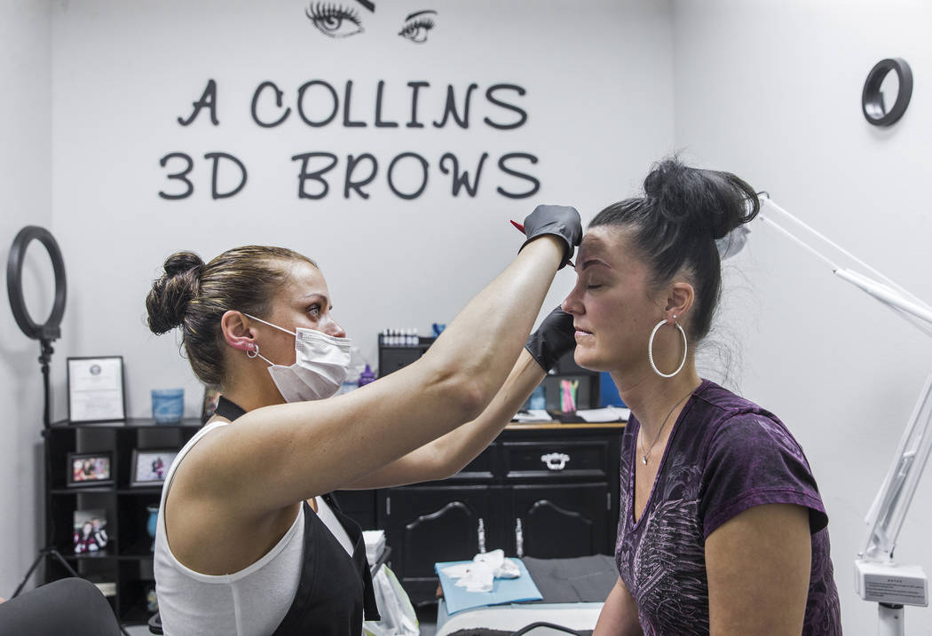 Audrey Collins, left, microblades Angie Lapp's eyebrows at The Body Spa Salon on Tuesday, April 18, 2017, in Henderson. Benjamin Hager Las Vegas Review-Journal @benjaminhphoto