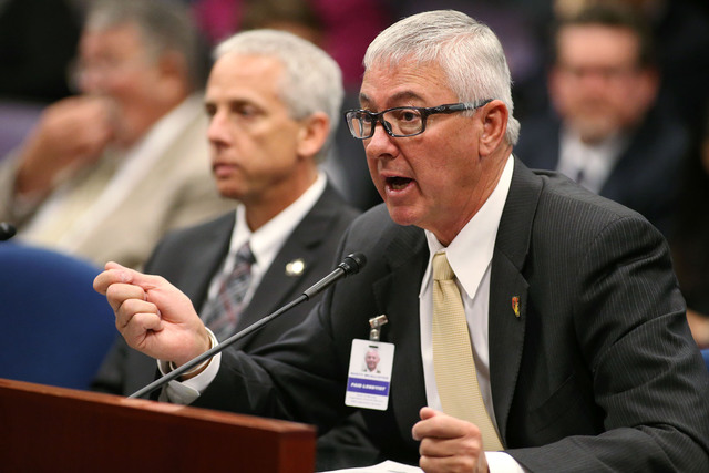 Rusty McAllister, representing Professional Fire Fighters of Nevada, testified at the Legislative Building in Carson City, Nev., on Friday, April 24, 2015, on a bill requiring local governments to ...