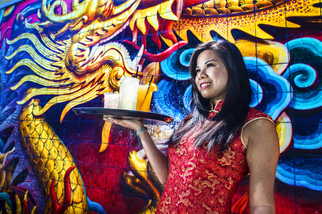 Server Q.Q. Zhai holds cocktails at the private pool at the Lucky Dragon hotel-casino on Thursday, April 20, 2017, in Las Vegas. Benjamin Hager Las Vegas Review-Journal @benjaminhphoto