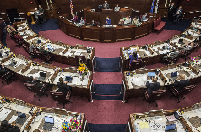 Assembly Speaker Jason Frierson, top/middle, leads applause for a fellow assemblymen's family member during the second day of the Nevada Legislative session on Tuesday, Feb. 7, 2017, at the Legisl ...