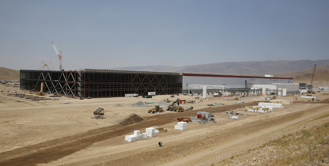 Construction continues on the new Tesla Gigafactory during a media tour Tuesday, July 26, 2016, in Sparks, Nev.  (AP Photo/Rich Pedroncelli)