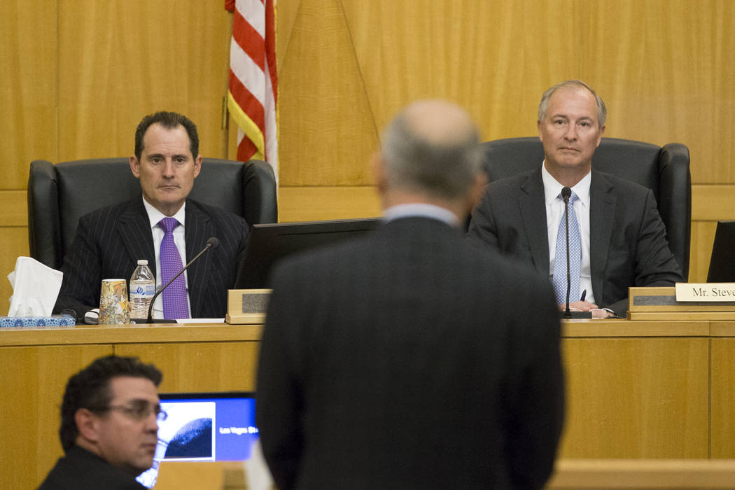 Board members Lawrence Epstein, left, and Steve Hill listen to Oakland Raiders President Marc Badain during a Las Vegas Stadium Authority meeting at the Clark County Government Center on Thursday, ...