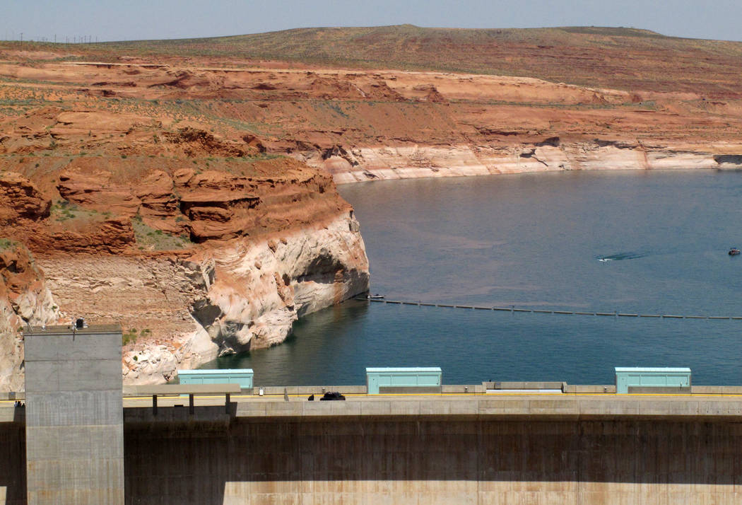 This photo taken Sunday, June 21, 2015, shows Glen Canyon Dam, in Page, Ariz., which was built to form Lake Powell. The U.S. Bureau of Reclamation is wrapping up a project to replace the eight tur ...