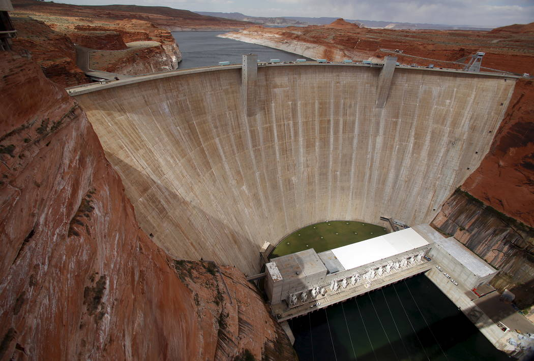 The Glen Canyon Dam can be seen with low water levels of the Colorado River fed Lake Powell outside Page, Ariz., April, 14, 2015. Picture taken April, 14, 2015. Jim Urquhart Reuters