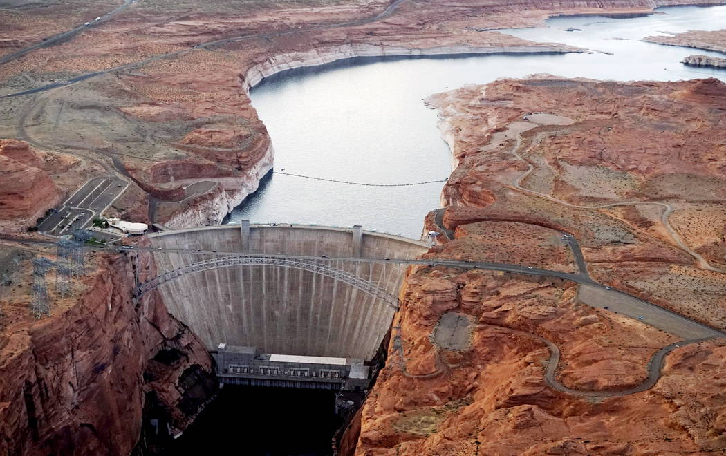 The Glen Canyon dam holds back the Colorado River creating Lake Powell near Page, Ariz., May 26, 2015. The lake provides water for Nevada, Arizona and California. A severe drought in recent years, ...