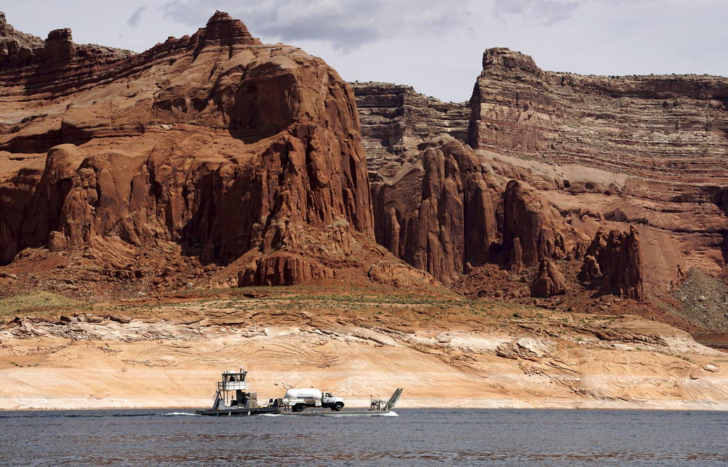 A barge carries a propane truck on Lake Powell near Page, Ariz., May 27, 2015. Lake Powell on the Colorado River provides water for Nevada, Arizona and California. A severe drought in recent years ...