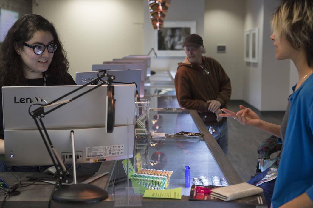 Budtender Maria Ruiz, left, rings up a customer at BLM Las Vegas Medical Marijuana Dispensary on Wednesday, March 1, 2017, in Las Vegas.  (Bridget Bennett/Las Vegas Review-Journal) @bridgetkbennett