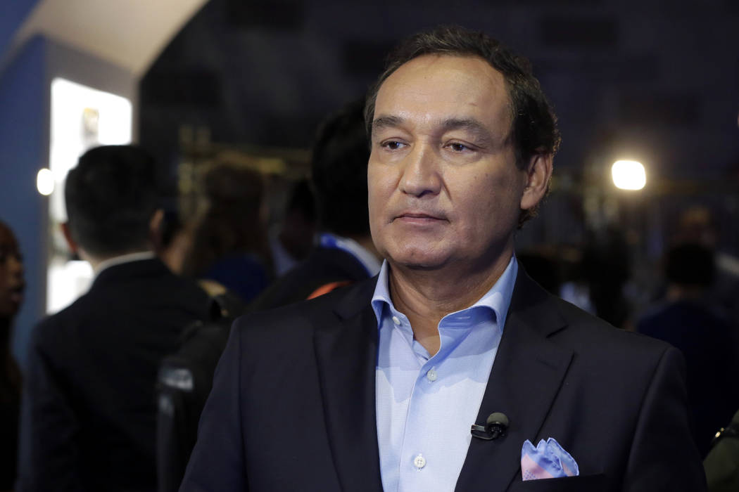 United Airlines CEO Oscar Munoz waits to be interviewed June 2, 2016, in New York. (Richard Drew/File, AP)