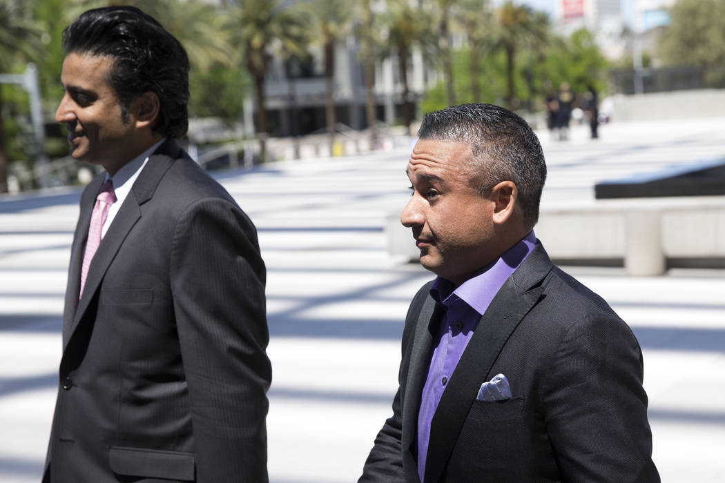 "David Oancea, right, a professional sports gambler who goes by the nickname ""Vegas Dave,"" and his attorney Paul Padda walk to the Lloyd George U.S. Courthouse on Wednesday, April 19, 2017, in  ..."