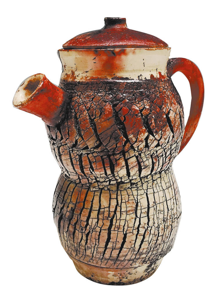 """""""Tezcatlipoca's,"""" a Mentors' Award winner by Ashley Ortega of Rancho Ceramics Studio at Rancho High School, is named after an Aztec deity and is a wheel-turned teapot that involved the use of some ..."""