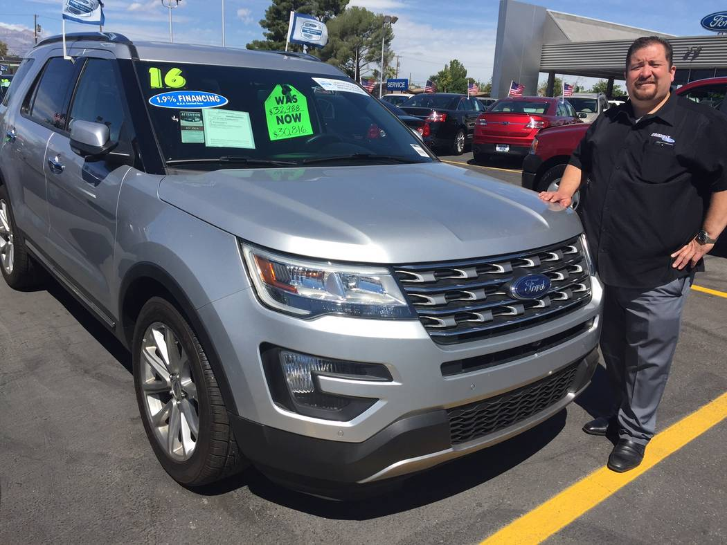 Friendly Ford Friendly Ford's used car manager Art Muro is seen with a certified pre-owned 2016 Ford Explorer sport utility vehicle at the dealership situated at 660 N. Decatur Boulevard.