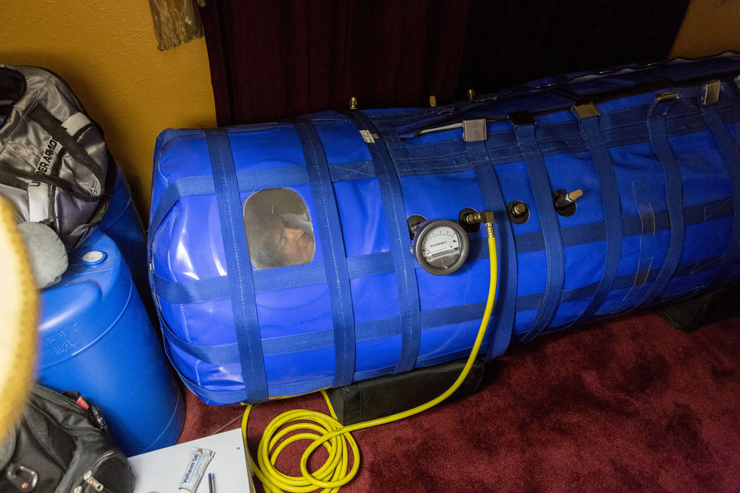 Author and former Air Force major Anthony Jones who suffers from major brain injuries from Iraq, lays in his hyperbaric oxygen chamber in his home in Las Vegas, Wednesday, April 19, 2017. Elizabet ...