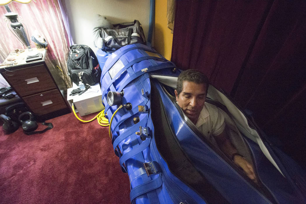 Author and former Air Force major Anthony Jones who suffers from major brain injuries from Iraq, gets out of his hyperbaric oxygen chamber in his home in Las Vegas, Wednesday, April 19, 2017. Eliz ...