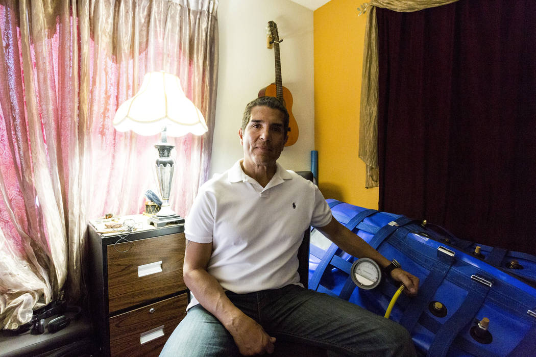 Author and former Air Force major Anthony Jones who suffers from major brain injuries from Iraq, is next to his hyperbaric oxygen chamber in his home in Las Vegas, Wednesday, April 19, 2017. Eliza ...