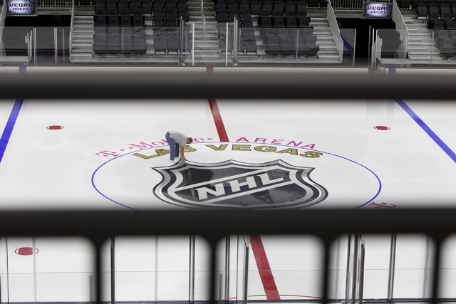 An ice installer lays out the logo for the NHL rink on Saturday, June 30, 2016, at the T-Mobile Arena in Las Vegas. Loren Townsley/Las Vegas Review-Journal Follow @lorentownsley