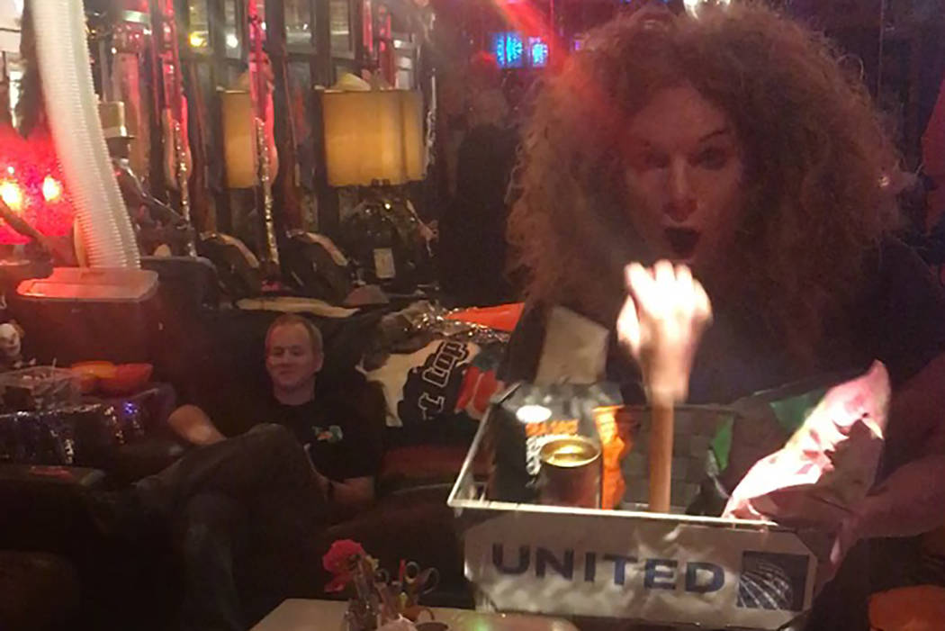 Carrot Top, shown backstage with his new United Airlines tray, a prop he introduced into his show on Monday night. (Jeff Molitz)