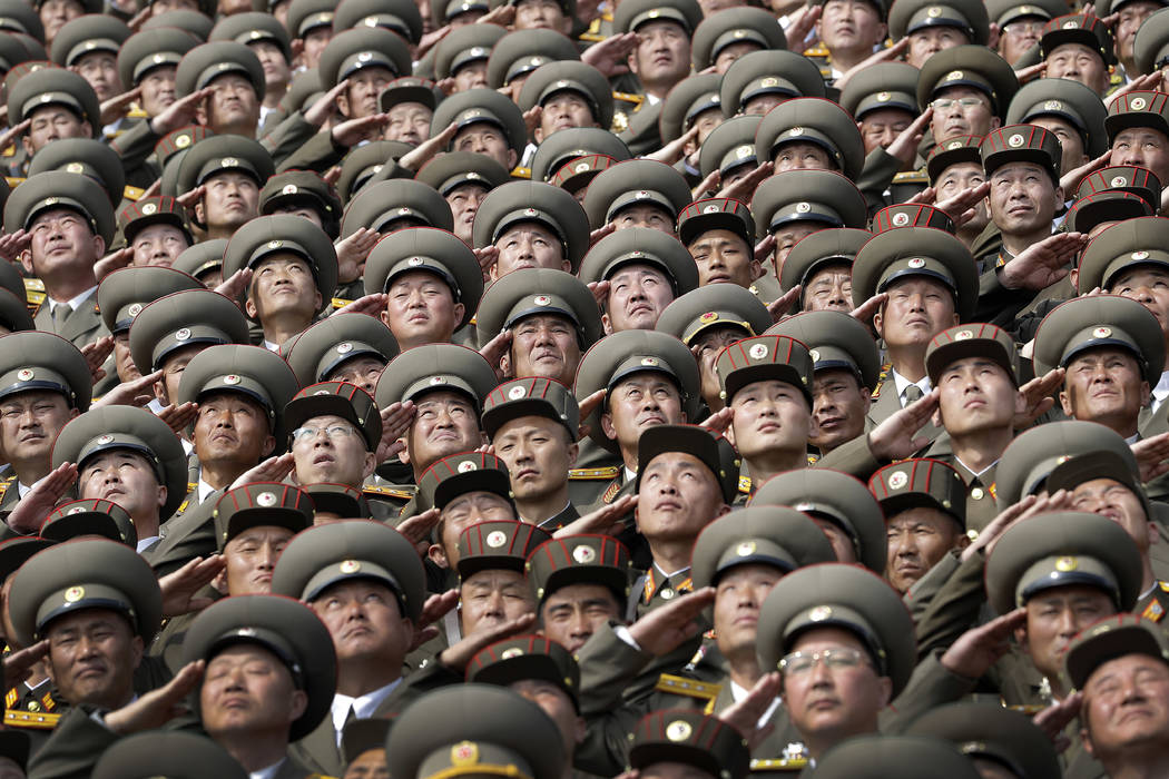 North Korean soldiers salute while the national anthem is played during a military parade on Saturday, April 15, 2017, in Pyongyang, North Korea to celebrate the 105th birth anniversary of Kim Il  ...