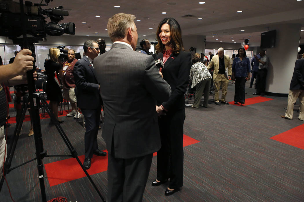 UNLV's new athletic director Desiree Reed-Francois speaks to a member of the media at the Thomas & Mack Center after a press conference on Tuesday, April 18, 2017, in Las Vegas. Christian K. L ...