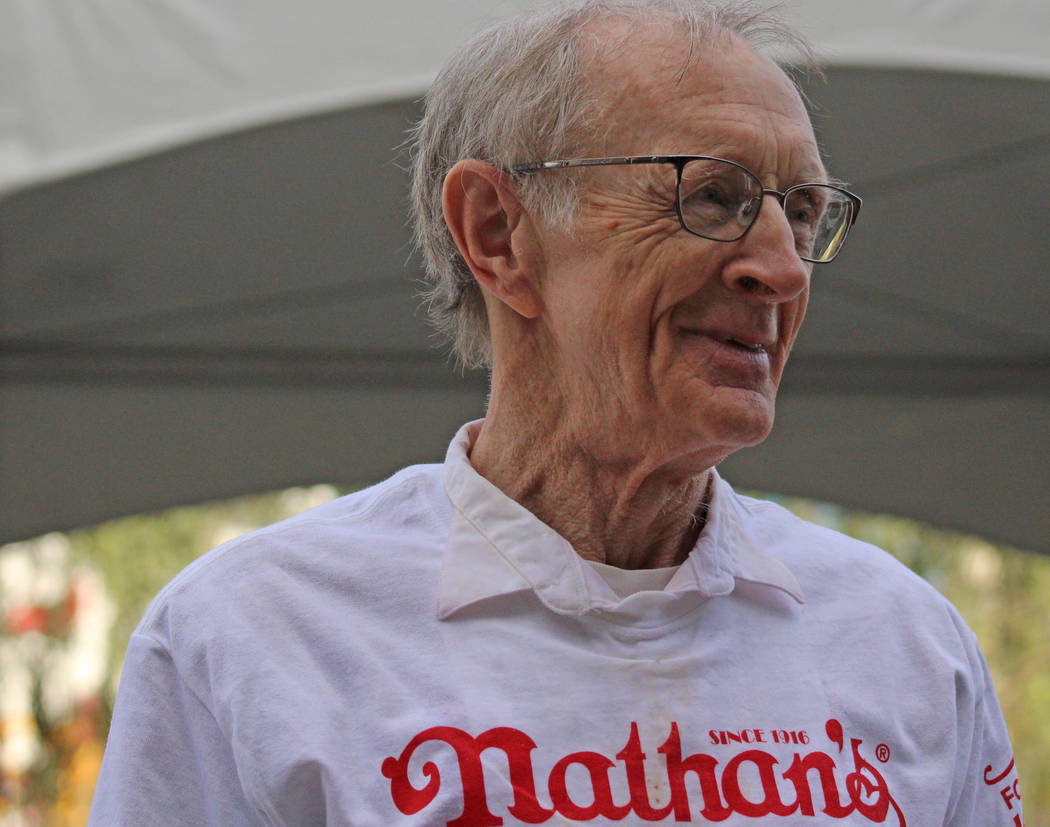 Rich LeFevre, 73, walks proudly off the stage after Nathan's Famous hosted the Nevada qualifier for the Fourth of July International Hot Dog-Eating Contest at New York New York hotel-casino, Satur ...