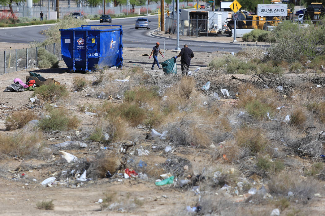 Volunteers clean a plot of land near the Edward Clark Generating Station in Las Vegas on Saturday, April 22, 2017. Brett Le Blanc Las Vegas Review-Journal @bleblancphoto