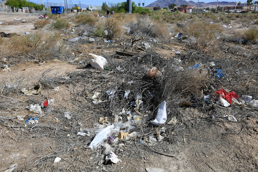 Litter collects near bushes in a plot of land near the Edward Clark Generating Station in Las Vegas on Saturday, April 22, 2017. Brett Le Blanc Las Vegas Review-Journal @bleblancphoto