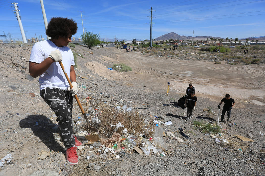 Octayveon Ducharm, a 15-year-old Bonanza High School student, helps clean a plot of land near the Edward Clark Generating Station in Las Vegas on Saturday, April 22, 2017. Brett Le Blanc Las Vegas ...