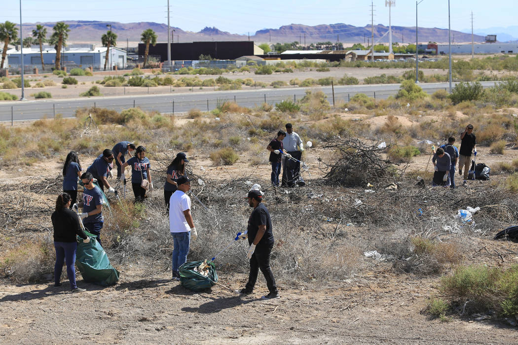 Volunteers clean a plot of land near the Edward Clark Generating Station in Las Vegas on Saturday, April 22, 2017. Brett Le Blanc Las Vegas Review-Journal @bleblancphoto