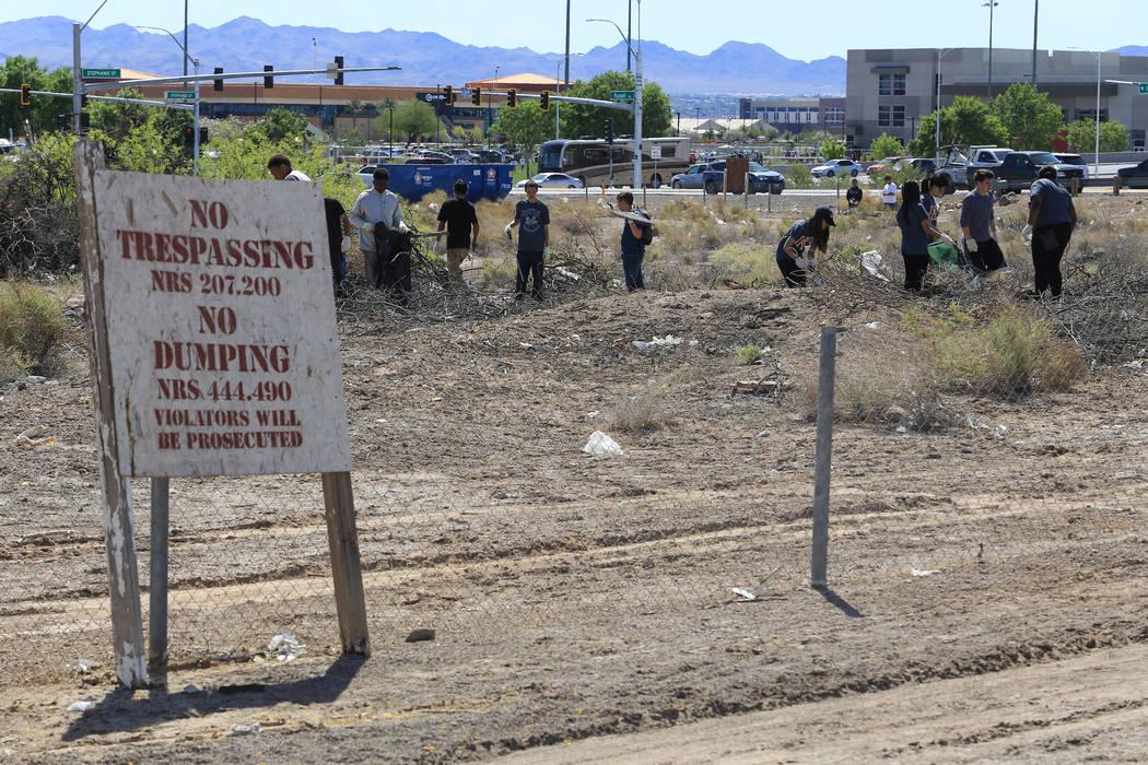 Volunteers help clean a plot of land near the Edward Clark Generating Station in Las Vegas on Saturday, April 22, 2017. Brett Le Blanc Las Vegas Review-Journal @bleblancphoto