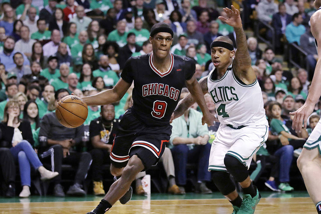Chicago Bulls guard Rajon Rondo (9) drives towards the basket past Boston Celtics guard Isaiah Thomas (4) during the second quarter of a first-round NBA playoff basketball game in Boston, Tuesday, ...