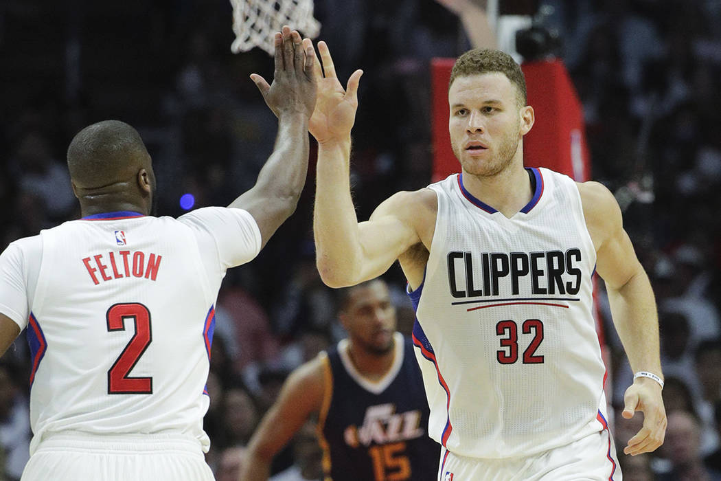Los Angeles Clippers' Blake Griffin, right, high-fives Raymond Felton after making a basket during the first half in Game 2 of an NBA basketball first-round playoff series against the Utah Jazz on ...