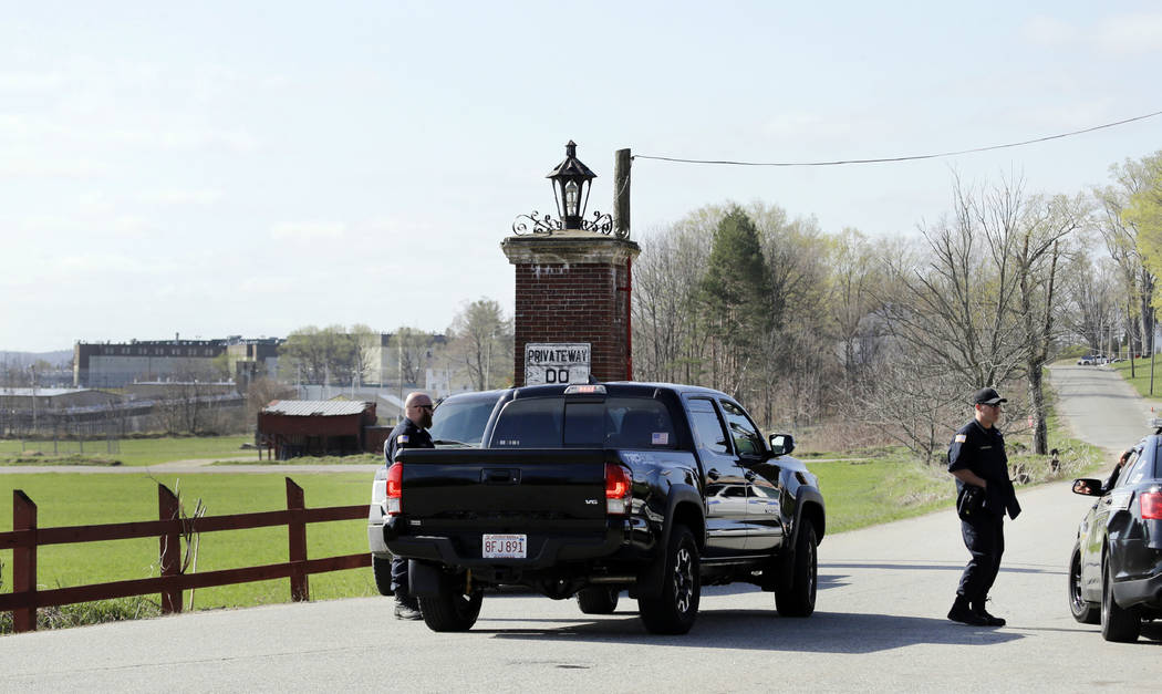 Police guard an entrance to the Souza-Baranowski Correctional Center, Wednesday, April 19, 2017, in Shirley, Mass. Former NFL star Aaron Hernandez, who was serving a life sentence for a murder con ...
